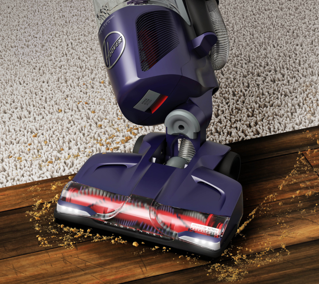Hoover vacuum cleaning up dirt