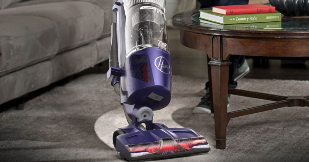 vacuum cleaning carpet in a living room