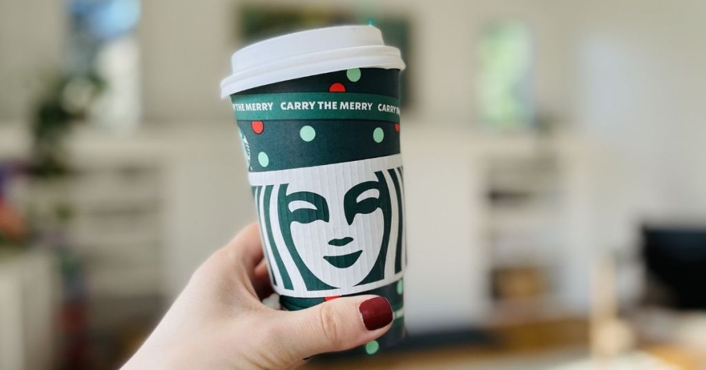 hand holding hot starbucks cup