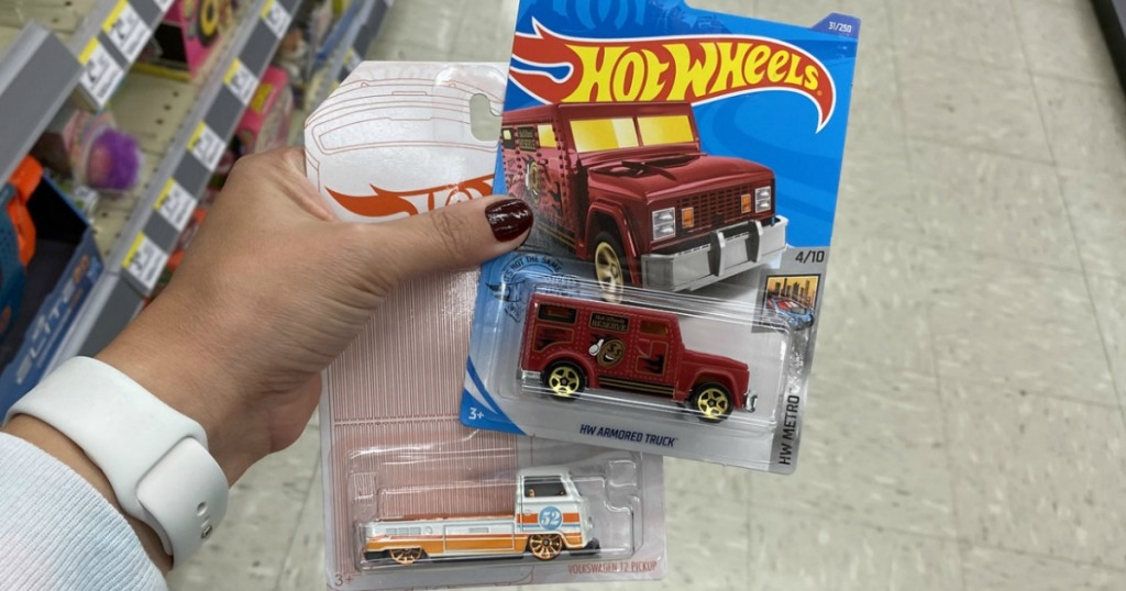 hand holding Hot Wheels Cars from Walgreens