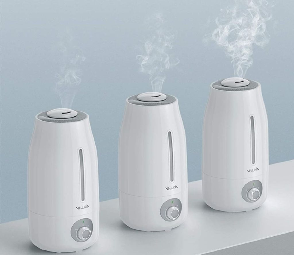 three humidifiers on a table