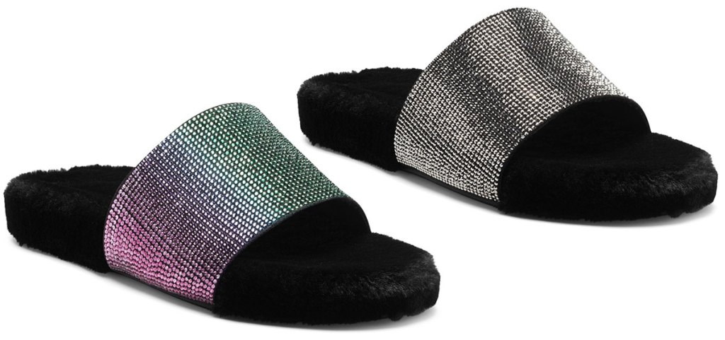 two pairs of black fuzzy slipper slides with rhinestones covering the top bands