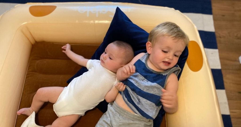 kids laying on an inflatable bed
