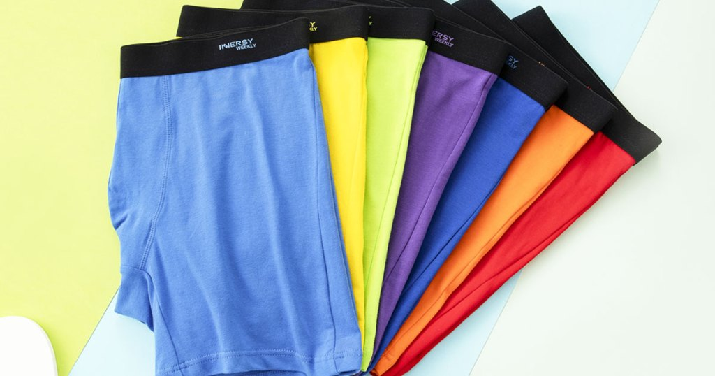 7 pairs of men's boxers in a rainbow of colors folded in half on top of one another