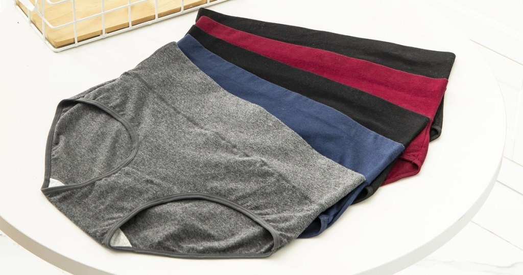 five pairs of women's high-waisted panties laying on a white table