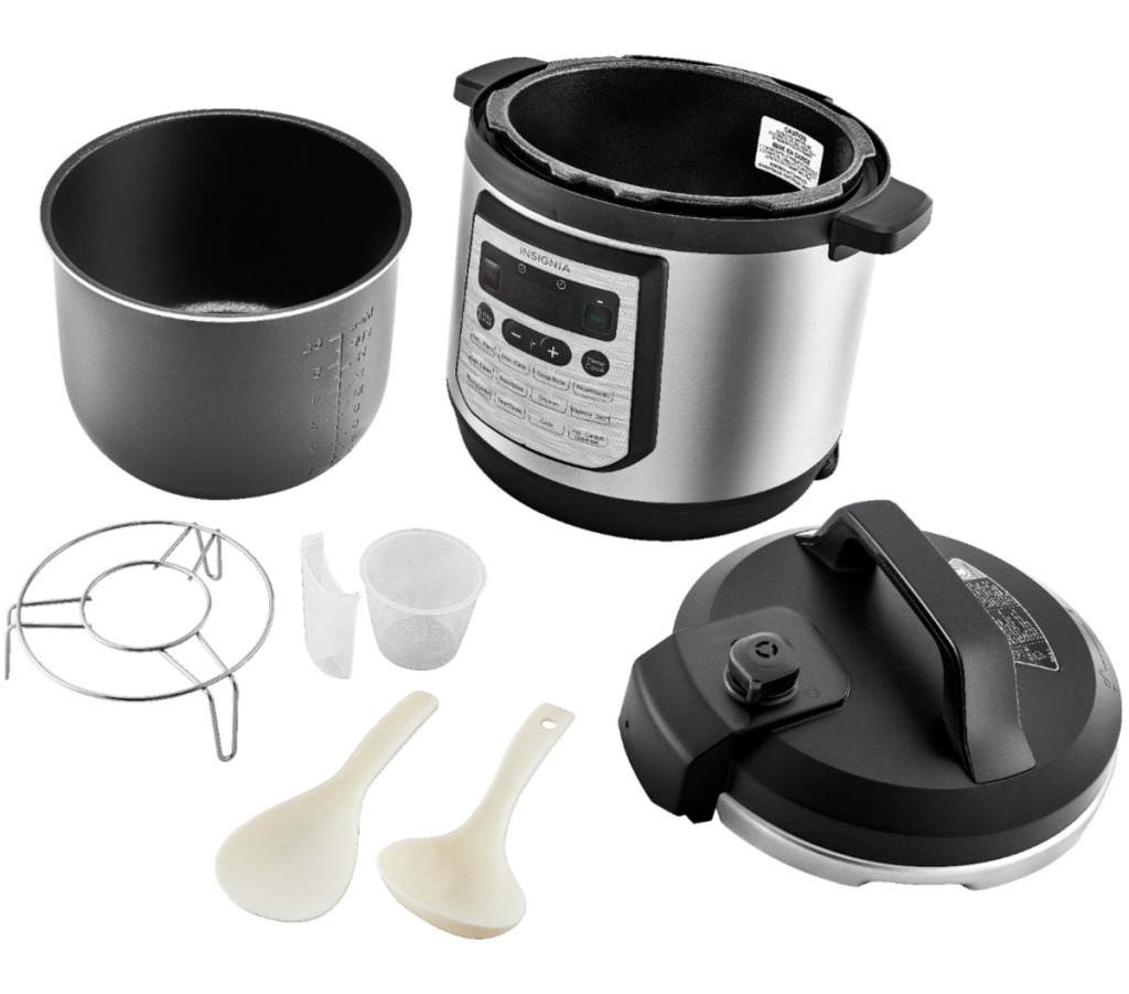 Large multi-cooker with accessories on white surface