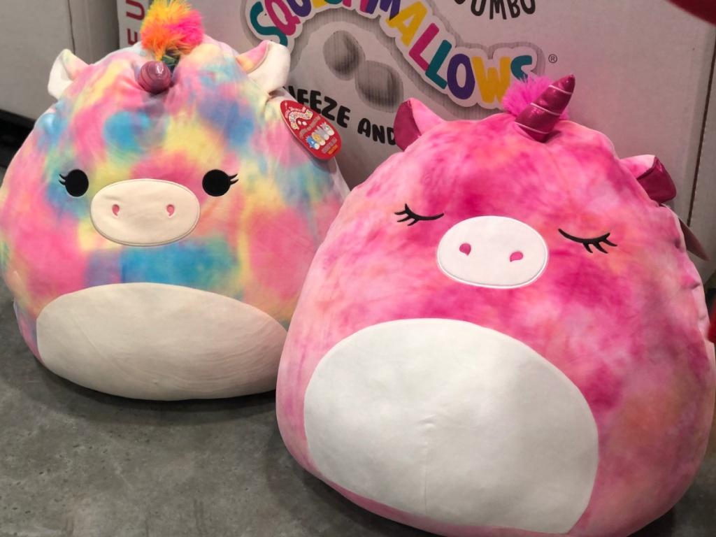 2 jumbo squishmallows sitting on the floor at Costco