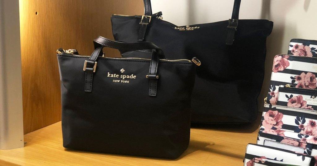 black kate spade tote bags on wood display shelf