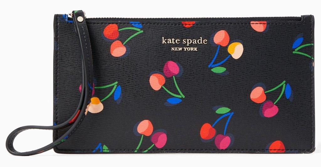black kate spade wristlet with multi-colored cherries print
