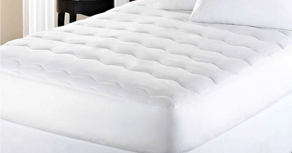 Kathy Ireland Home Essentials Mattress Pad in Full on bed