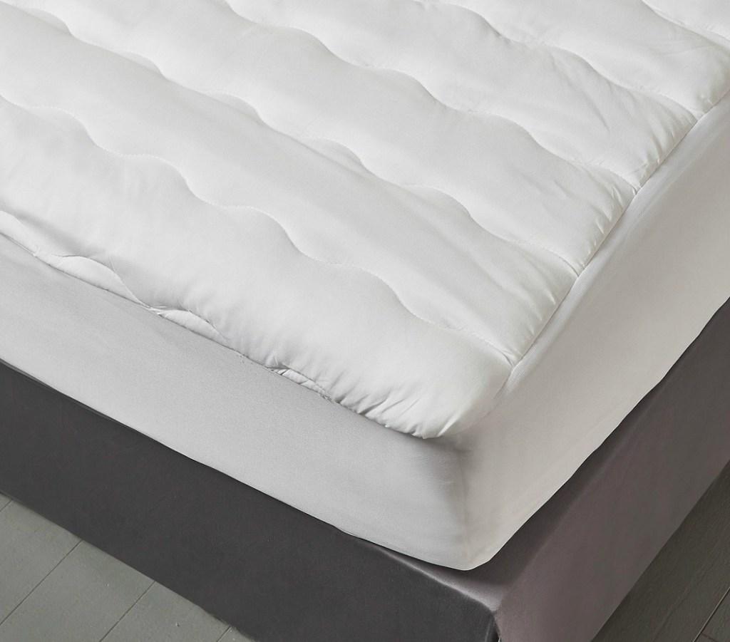 Kathy Ireland brand mattress pad