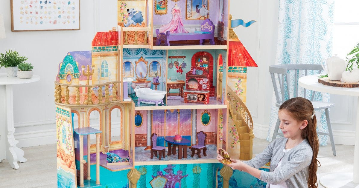 girl playing with Disney Ariel dollhouse