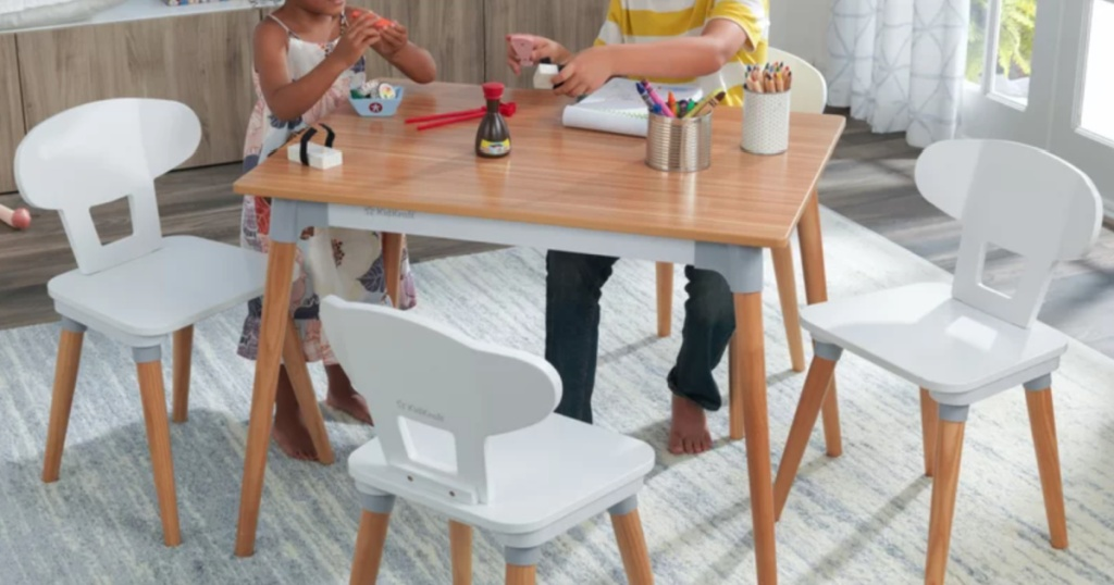 2 children sitting at a kidkraft table and chair set