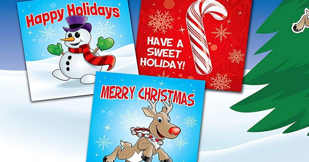 kartu natal anak-anak manusia salju, permen tongkat, dan rusa kutub
