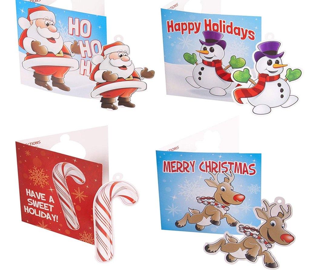 Kartu Natal anak-anak bertema santa, manusia salju, permen tongkat, dan rusa kutub dengan ornamen kertas pop-out