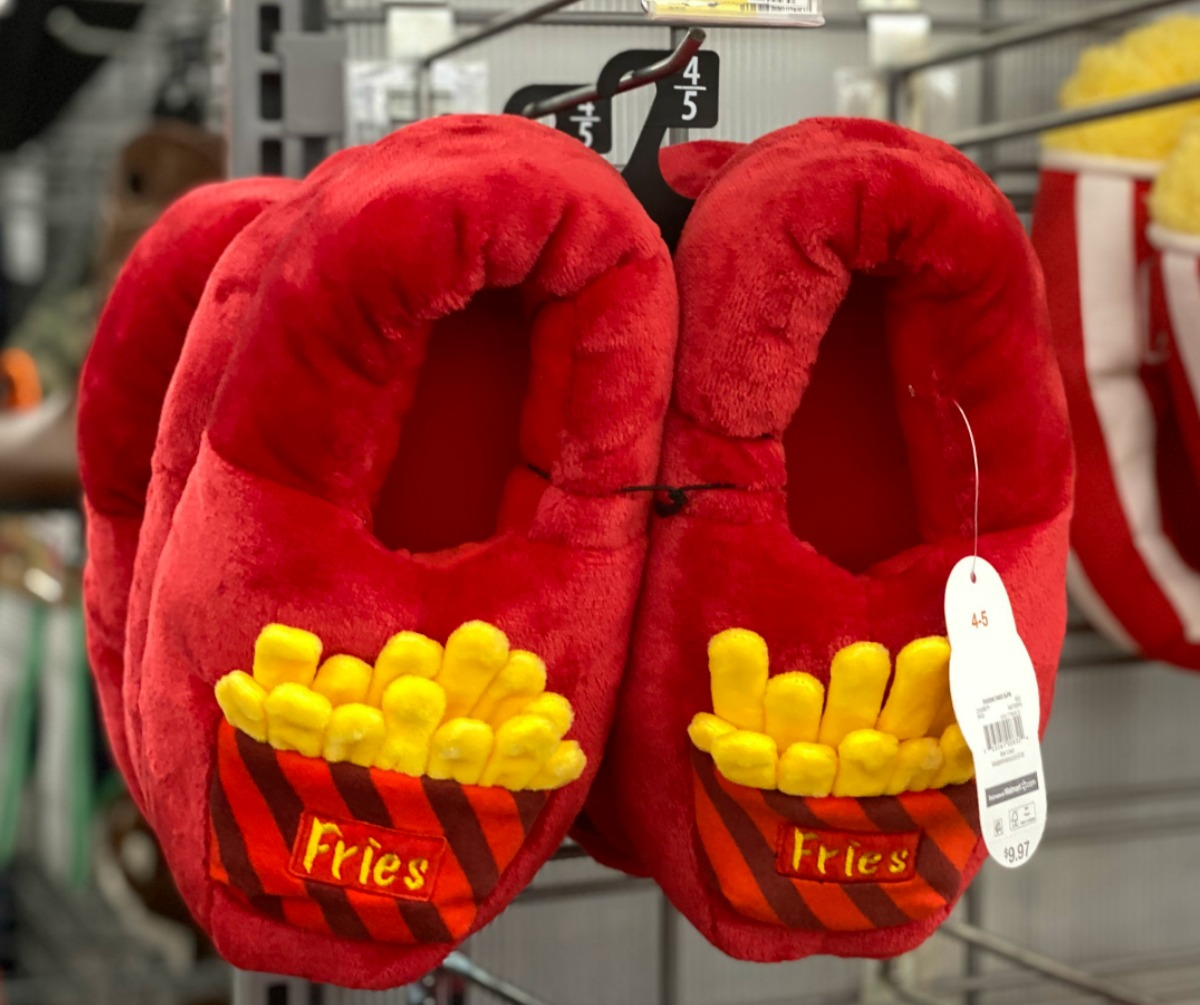 French fry themed slippers for kids hanging from an in-store display