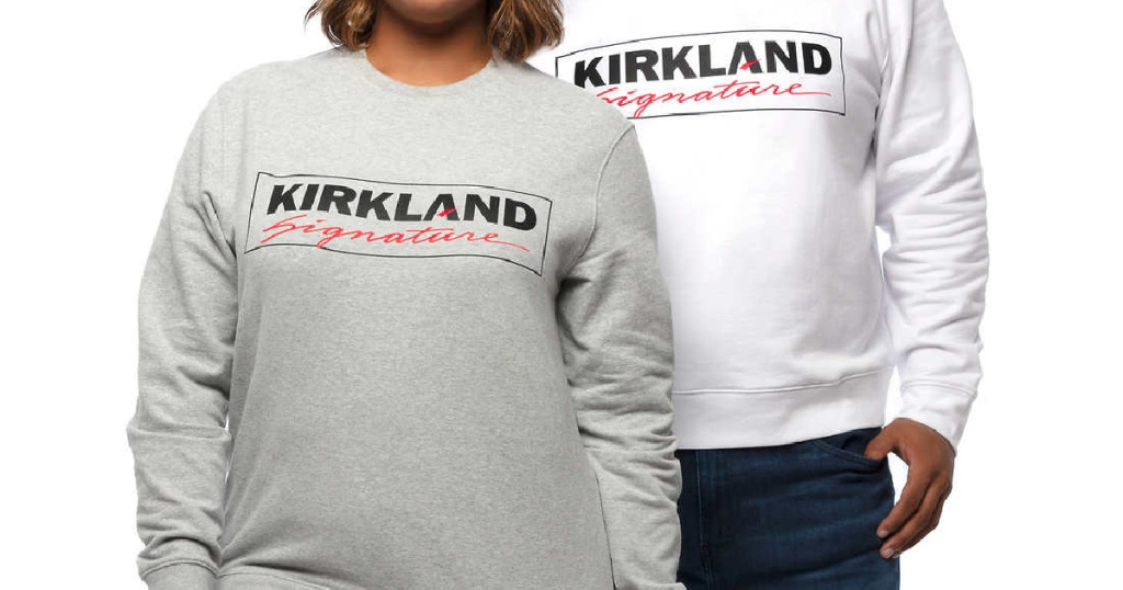 woman in grey logo sweatshirt dan man in white logo sweatshirt