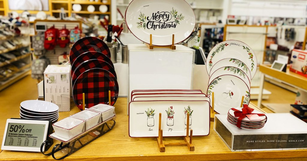 display table at kohls full of christmas dinnerware and platters