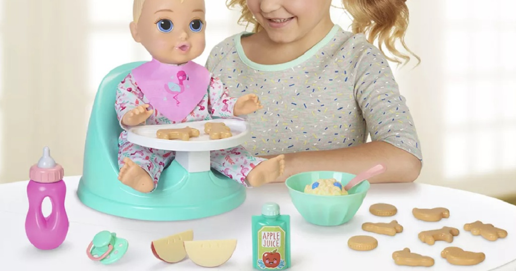 little girl playing with a be my baby doll