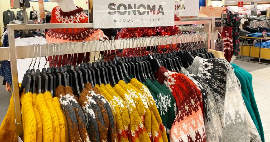 display of women's sweaters at kohl's with a sonoma goods for life sign above them