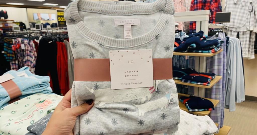 woman's hand holding LC Lauren Conrad Pajamas