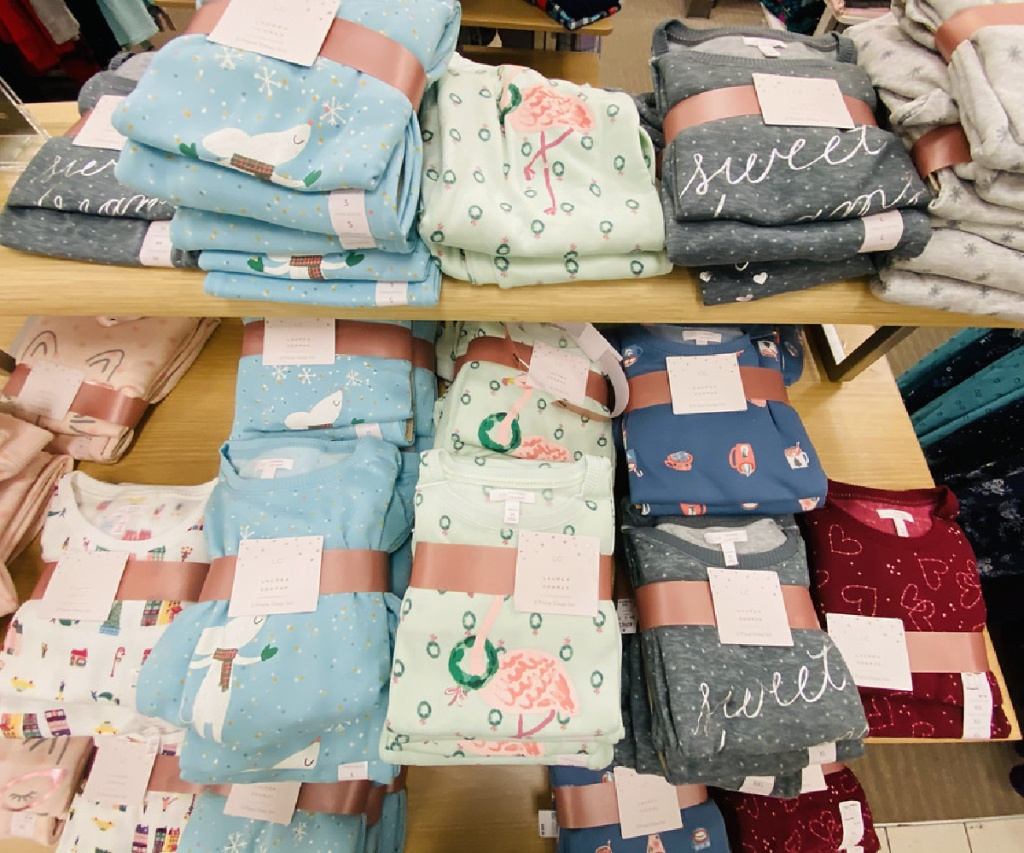 pajama sets folded on display table in store