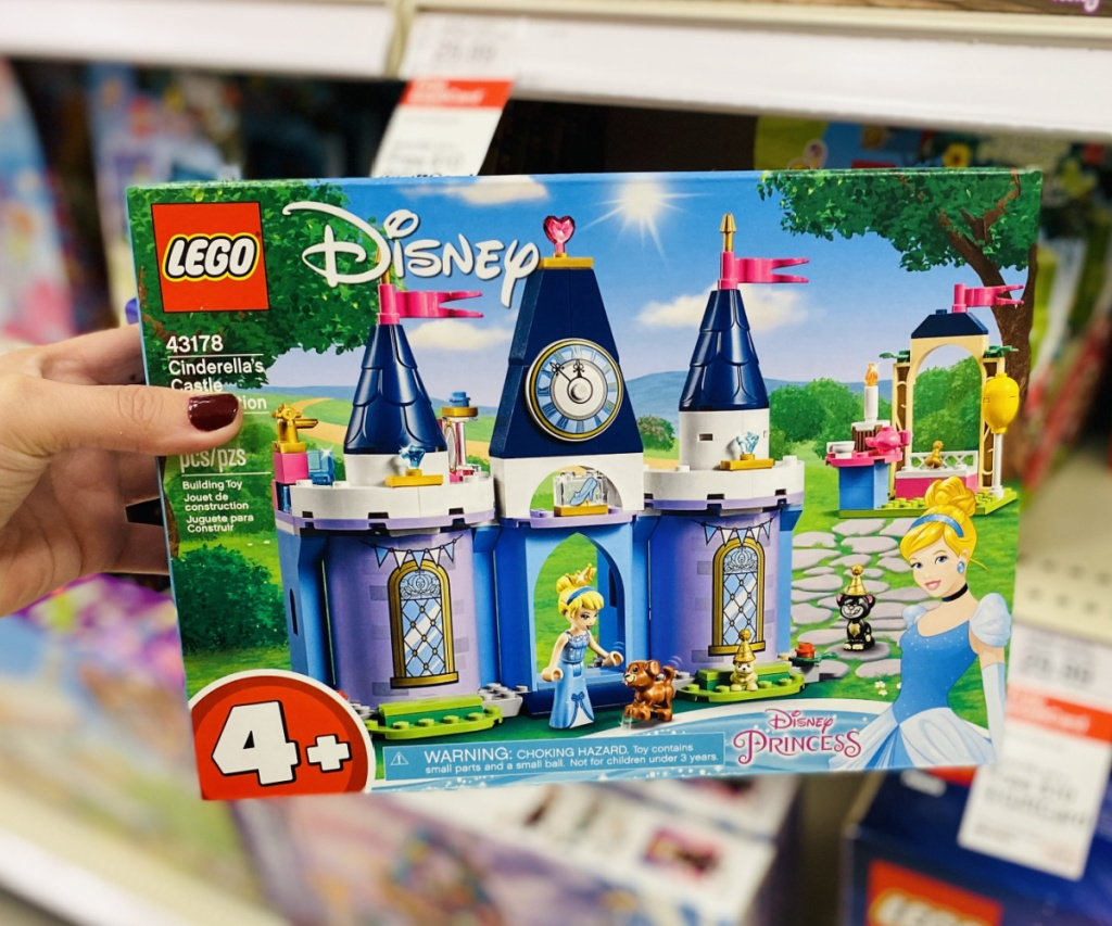 hand holding LEGO Disney Princess kit in store