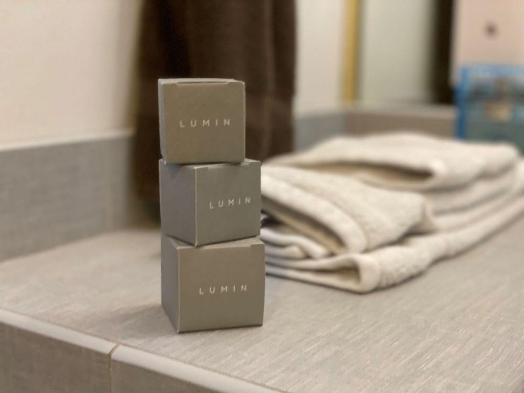 three boxes of Lumin skincare