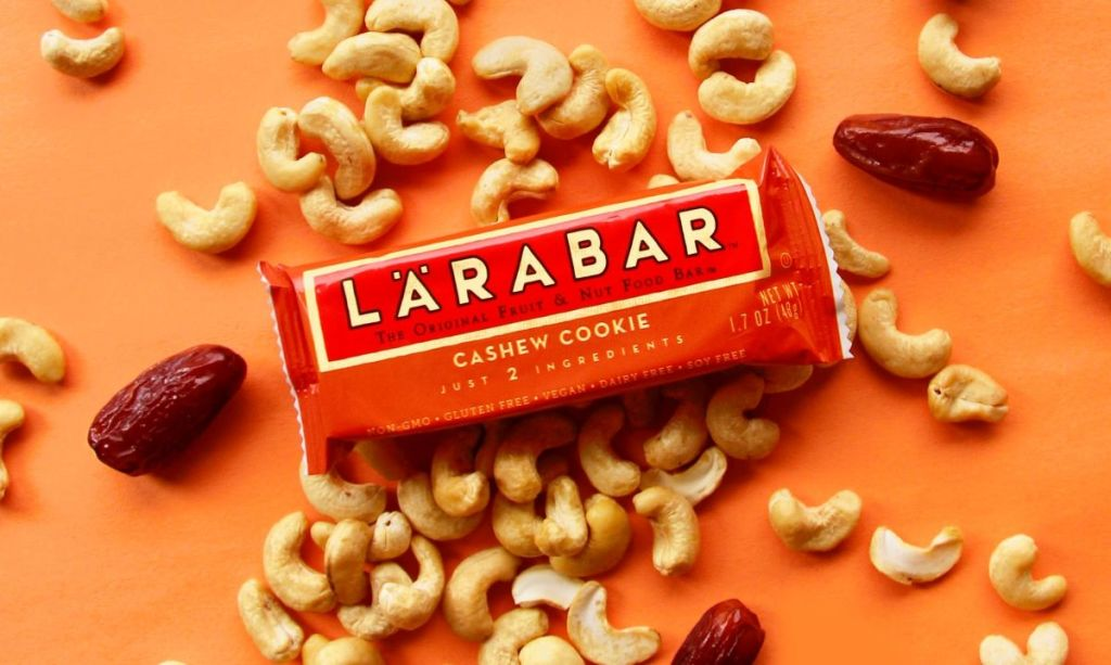 Larabar Cashew Cookie surrounded by cashews and dates