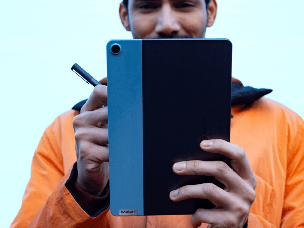 man holding Lenovo Chromebook Duet in the form of a tablet