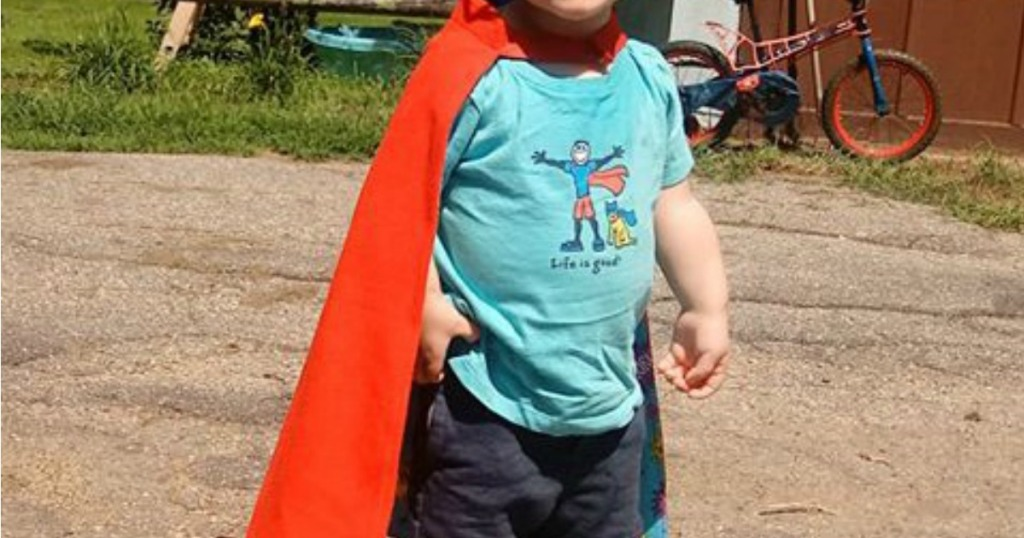 toddler wearing a cape