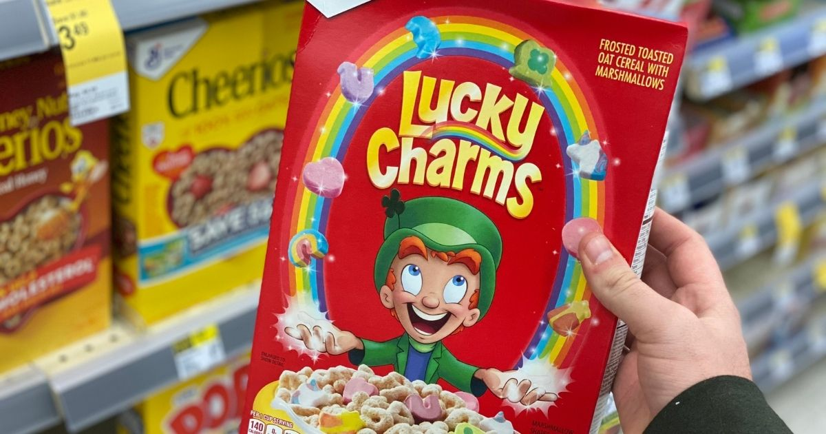 hand holding Lucky Charms Cereal