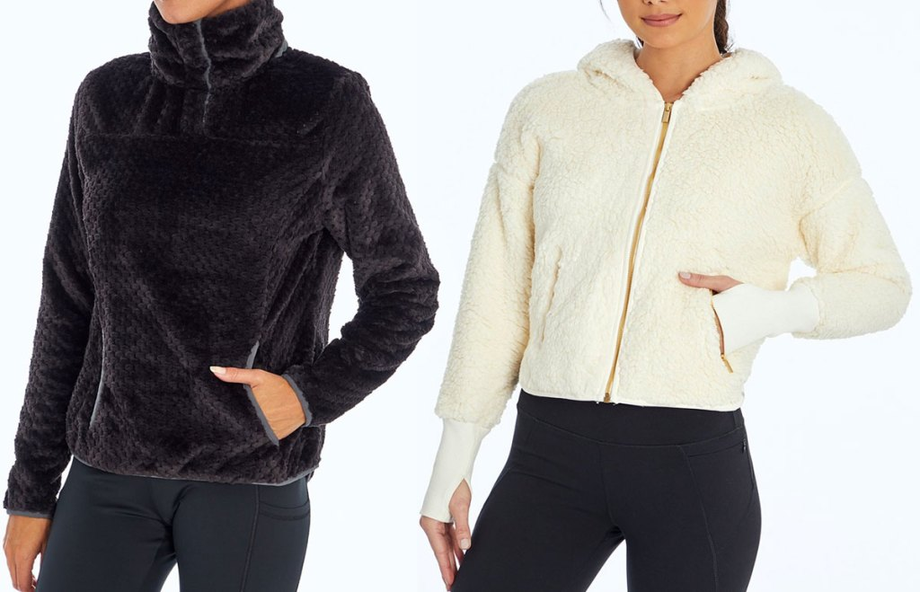 woman modeling blackplush pullover and woman in white fluffy zip-up jacket