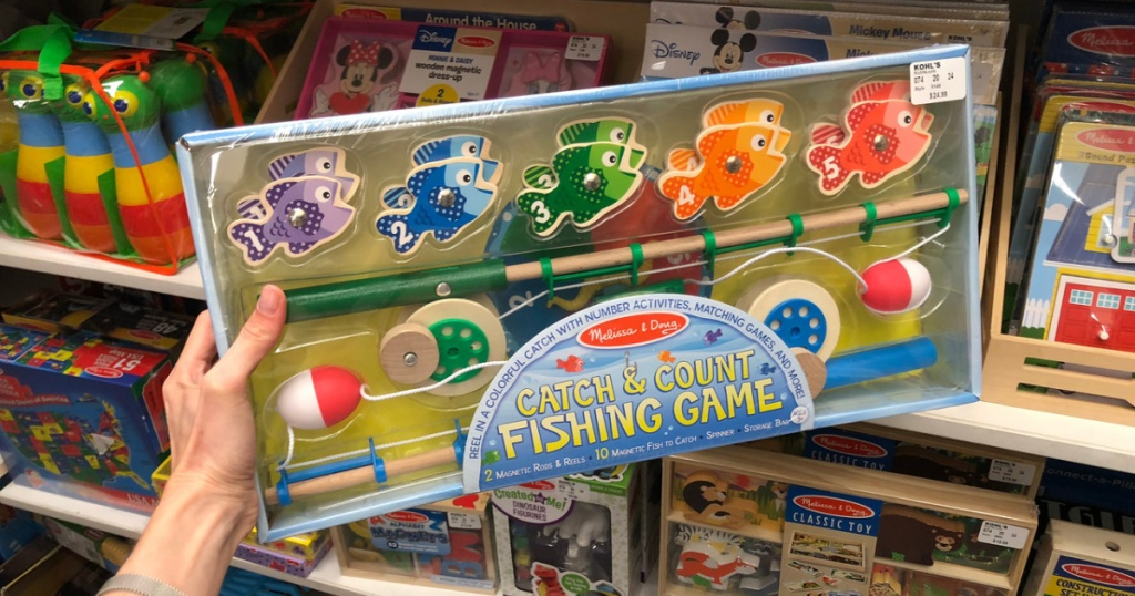 hand holding magnetic fishing game in store