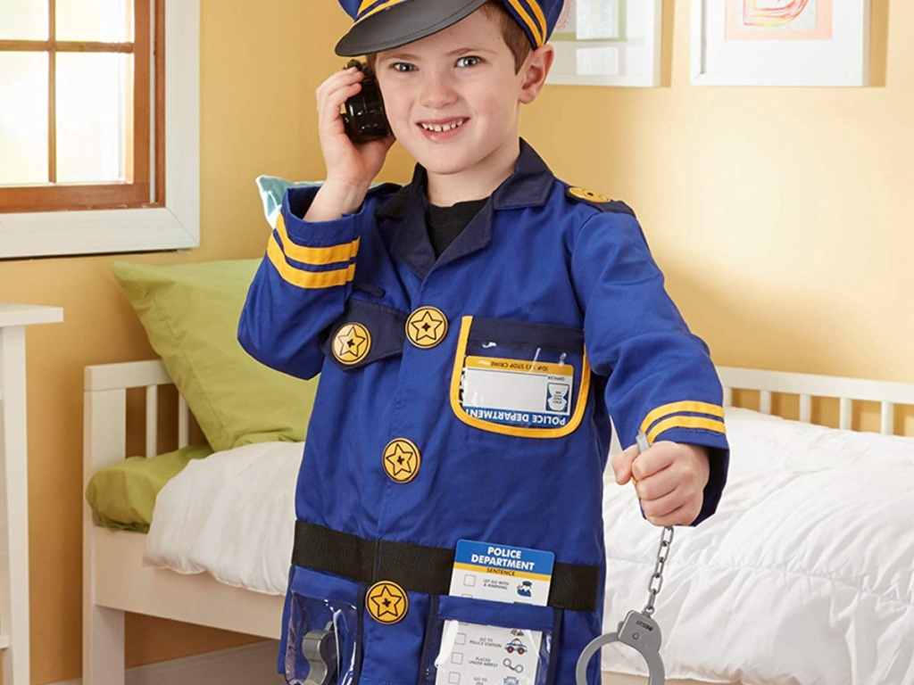 little boy wearing a melissa and doug police costume