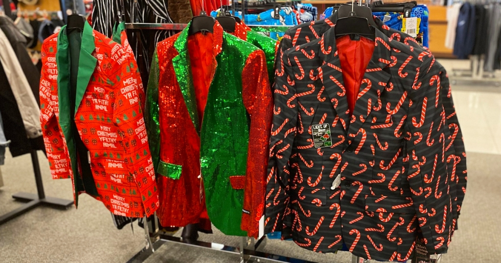 men's christmas blazers hanging on hangers on display at kohl's