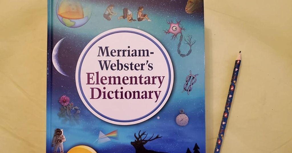 Merriam-Webster's Dictionary on a table with a pencil