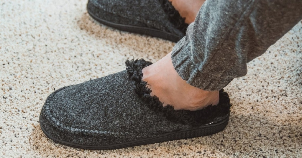 man wearing grey clog slippers
