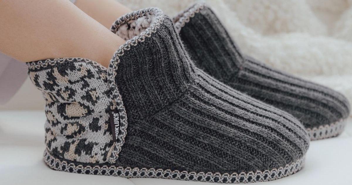 woman wearing Muk Luks Slippers