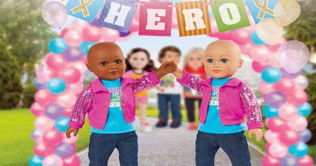 two bald dolls high-fiving under a balloon arch that says hero