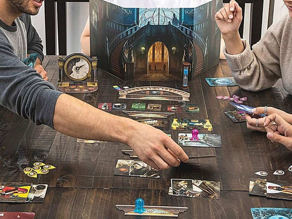 people playing Mysterium board game
