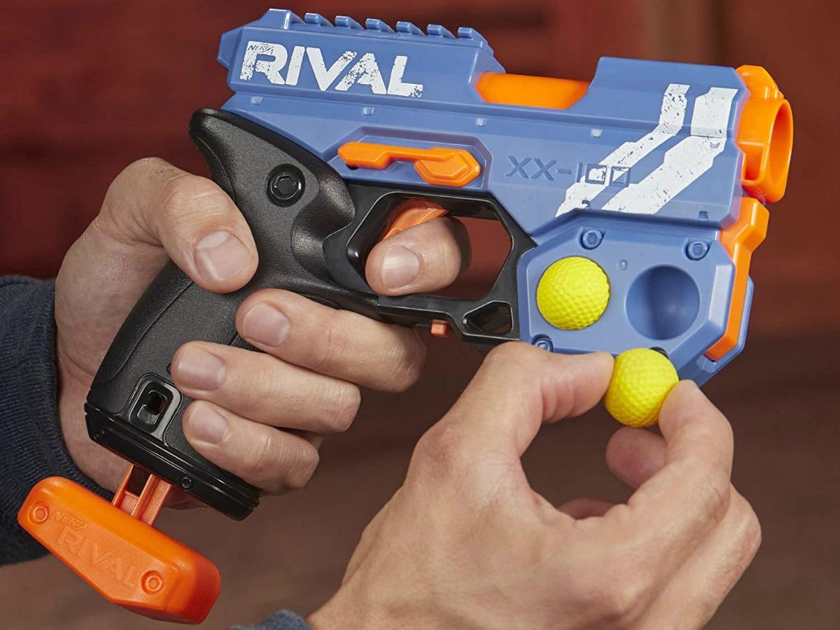 Man holding a plastic NERF gun