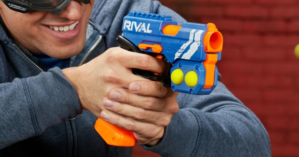 Man holding a small plastic toy weapon