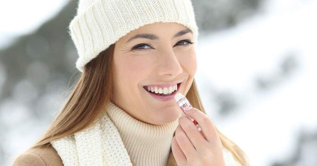Woman Using Naturisticks Lip Balms