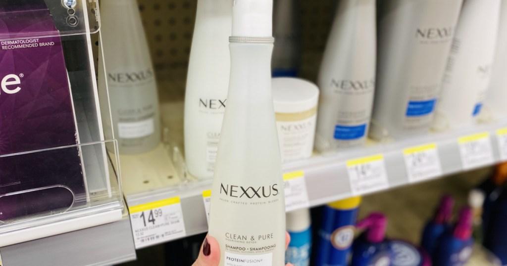 hand holding nexxus shampoo