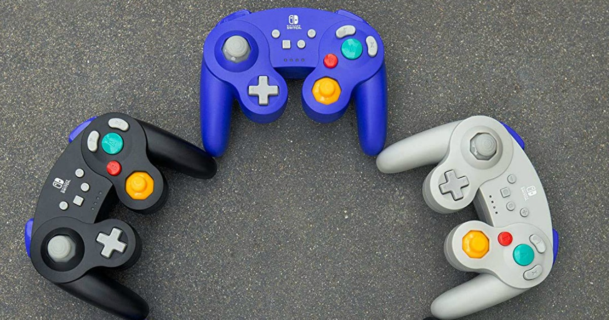 Three Nintendo Switch GameCube style controllers