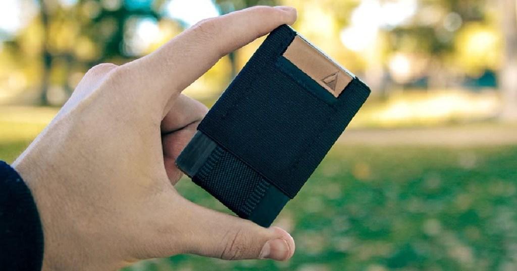 hand holding black slim wallet