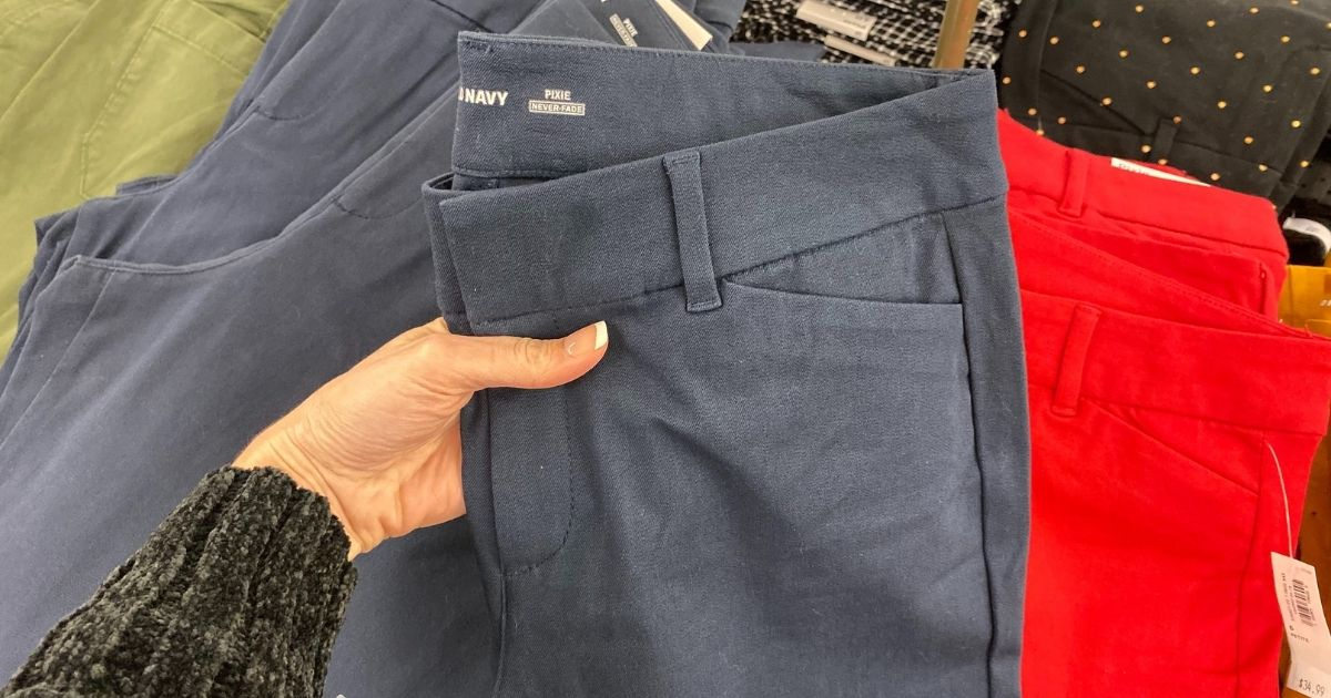 hand holding a pair of Old Navy Pixie pants