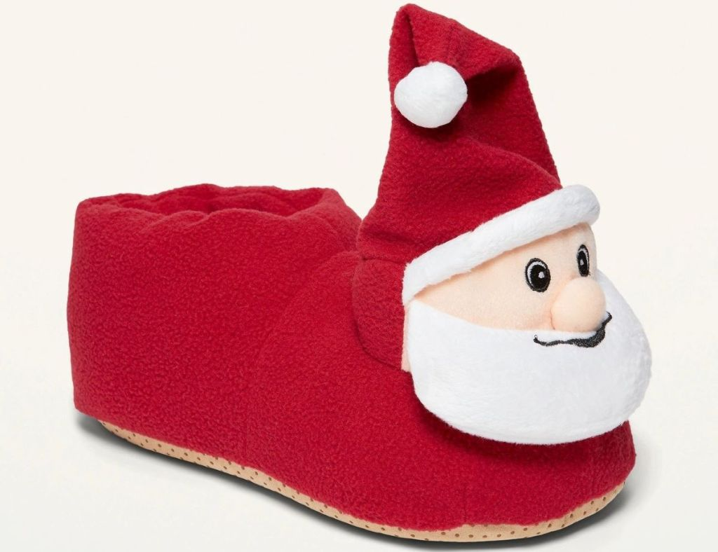 red slippers with Santa's head on the front