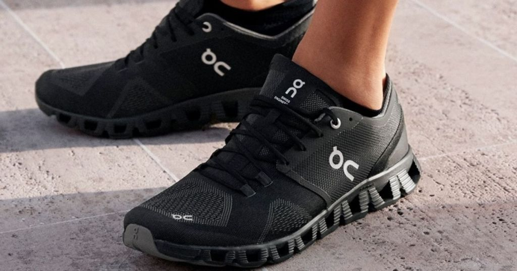 person wearing a pair of black running shoes